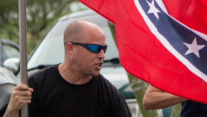 Jon Ritzheimer waves a Confederate flag outside a west