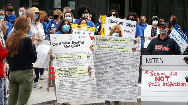 Members of the Providence Teachers Union rallied in front of the Rhode Island Department of Education on Tuesday .