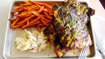 Kitchen Peppered Ribs with sweet potato fries and slaw at Woolworth on 5th.