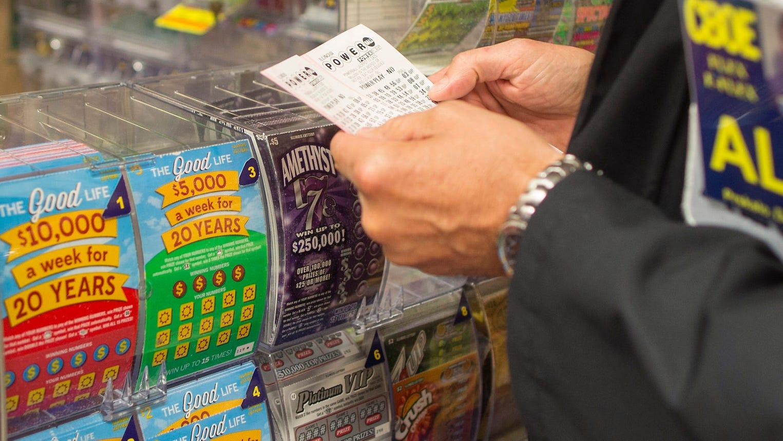Douglas Priskalo purchases Powerball tickets in Chicago.