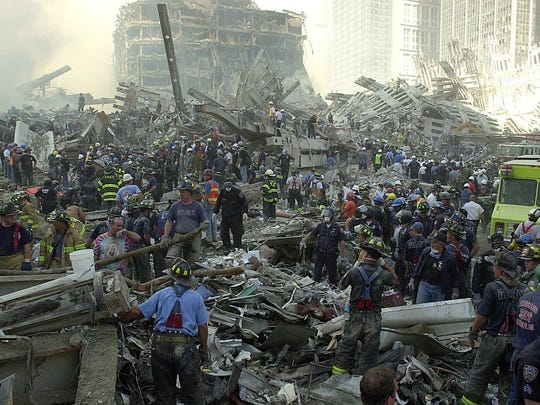 An army of rescue workers sifts through the rubble at Ground Zero on Sept. 12, 2001, during search and rescue efforts.