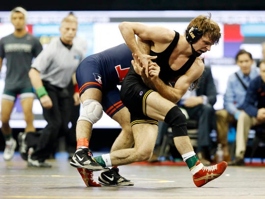 Iowa's Cory Clark tries to pull away from Illinois' Zane Richards Sunday, March 6, 2016, at the Big 10 Wrestling Championships in Iowa City.
