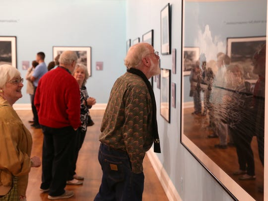 Jim Cosper examines Clyde Butcher's Florida Photographs exhibit, entitled Preserving Eden, which opened at the Museum of Florida History on Thursday, Feb. 9, 2017.
