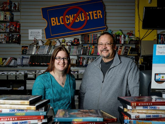Kira Dunn, left, and her father, Scott Shepherd, in The Village Vidiot, the last video rental store in Fort Collins, plans to close in August.