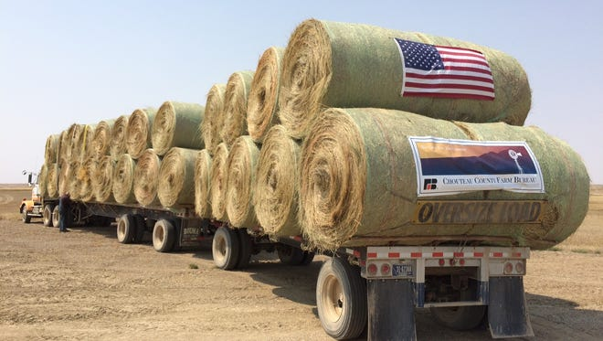 A truck owned by Roger Veigel of  Power, Montana stands loaded with donated hay destined for fire stricken ranches in eastern Motnana
