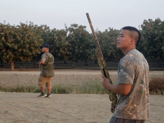With one shot left, Jasson Saesee and a fellow hunter