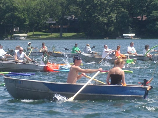 Boats were used as guides in the Goguac Lake Swim for