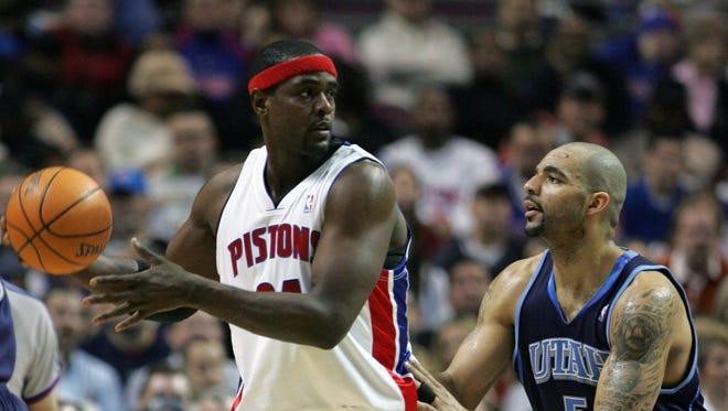 Pistons forward Chris Webber passes against Jazz forward Carlos Boozer on Jan. 17, 2007, at the Palace.