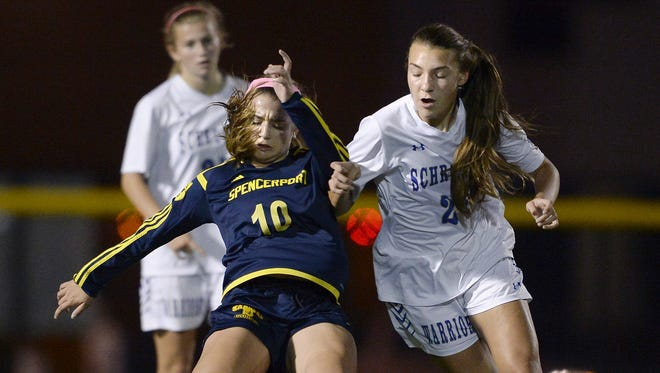Spencerport's Maddie Tortora, left, is defended by Webster Schroeder's Abby Neil.