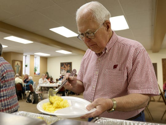 DIck Nelson serves himself eggs at the Parade Day Dairy
