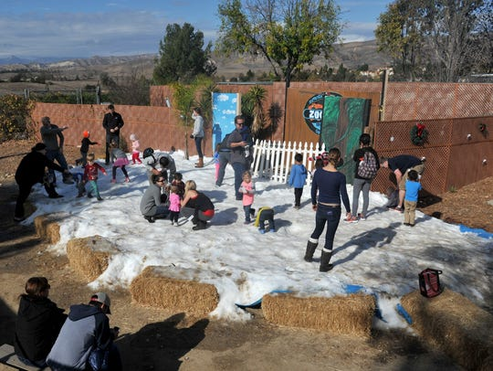 Visitors enjoy the snow at a past Arctic Lights event at America's Teaching Zoo at Moorpark College. This year's event will be Dec. 16 and 17.