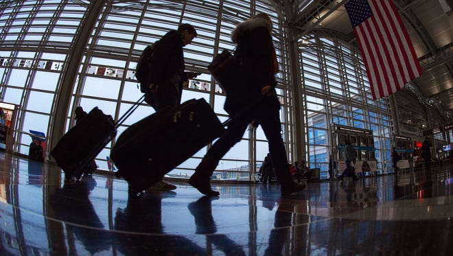 Travelers walk through Washington Reagan National Airport on Nov. 26, 2014, the busiest travel day of the year.