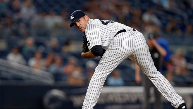 New York Yankees relief pitcher Blake Parker checks on a base runner during the seventh inning of a baseball game against the Tampa Bay Rays, Thursday, Sept. 8, 2016, in New York.