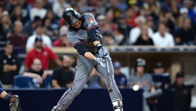 Arizona Diamondbacks' J.D. Martinez hits a RBI single during the third inning of a baseball game against the San Diego Padres, Monday, Sept. 18, 2017, in San Diego.