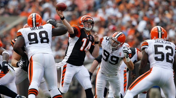 Cincinnati Bengals quarterback Andy Dalton (14) throws from the pocket against the Cleveland Browns in the first quarter during their season opener in Cleveland, Ohio. The Enquirer/Jeff Swinger