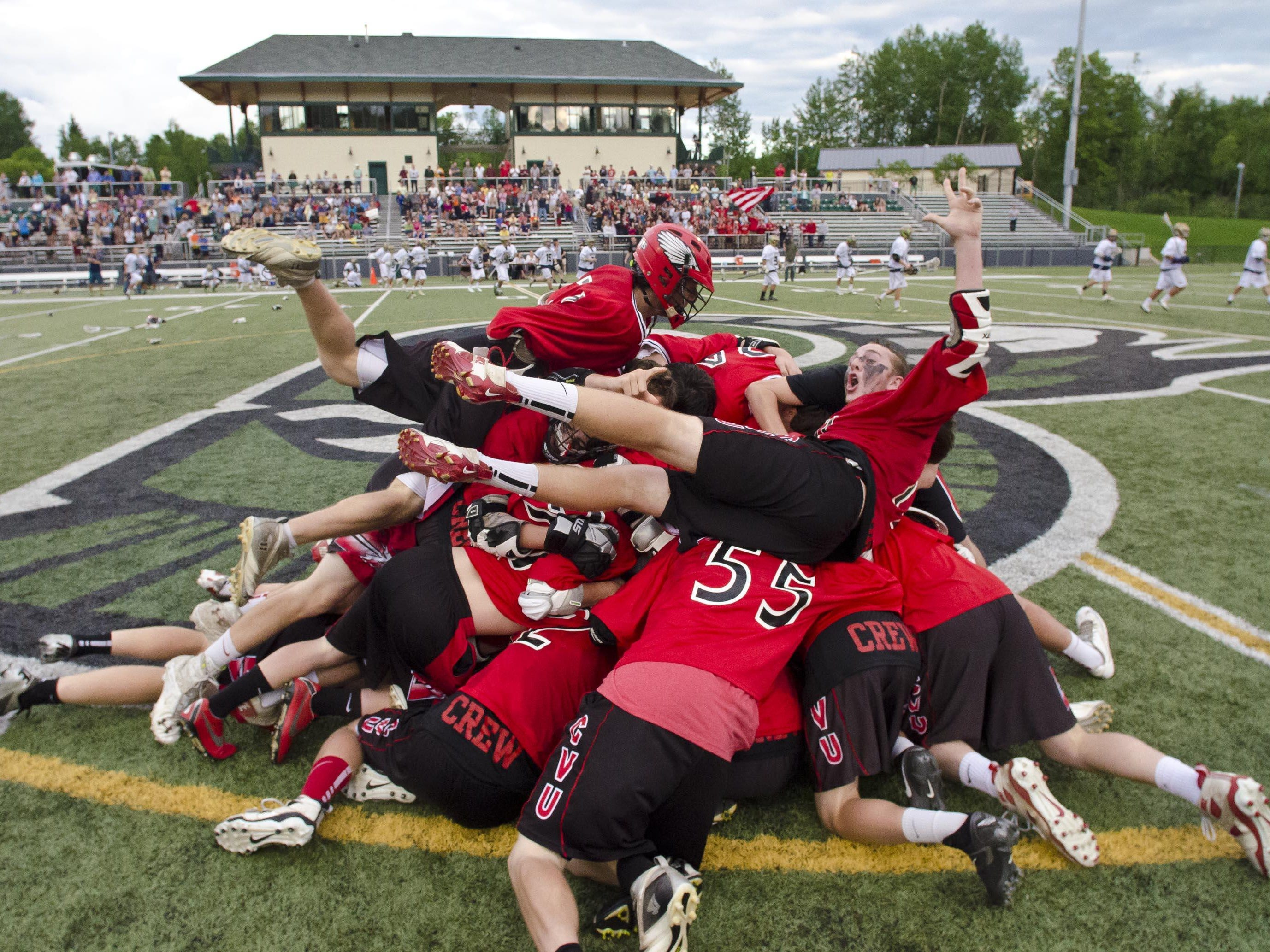 CVU celebrates its victory over Essex in the Division I state high school boys' lacrosse championships at Castleton State College on Monday, June 17, 2013.