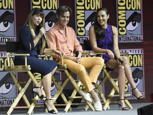 "Patty Jenkins, from left, Chris Pine and Gal Gadot speak at the Warner Bros. Theatrical panel for ""Wonder Woman 1984."""