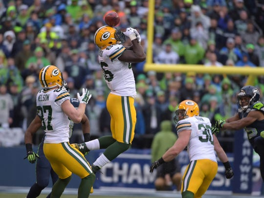 Jan 18, 2015; Seattle, WA, USA; Seattle Seahawks wide receiver Chris Matthews (13) recovers an onside kick that bounces off the helmet of Green Bay Packers tight end Brandon Bostick (86) as receiver Jordy Nelson (87) and fullback John Kuhn (30) react in the NFC Championship at CenturyLink Field. The Seahawks defeated the Packers 28-22 in overtime. Mandatory Credit: Kirby Lee-USA TODAY Sports