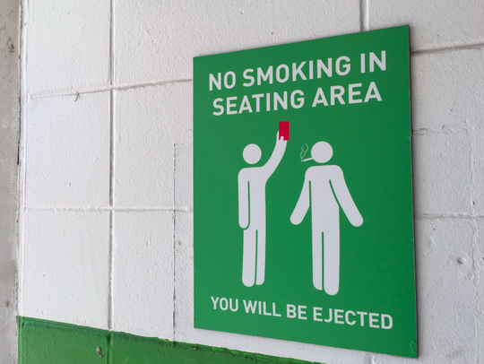 "A soccer-minded ""no smoking"" sign is one of many accoutrements"