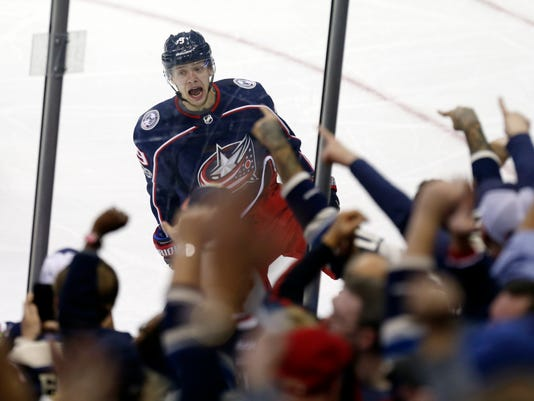 Columbus Blue Jackets forward Artemi Panarin, of Russia, celebrates his goal against the New York Rangers during the third period of an NHL hockey game in Columbus, Ohio, Friday, Oct. 13, 2017. The Blue Jackets won 3-1. (AP Photo/Paul Vernon)