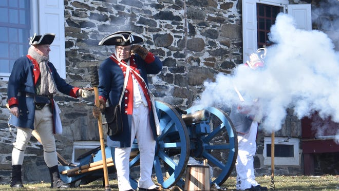 Members of the Fifth Connecticut Regiment, a re-enactment group, fire a cannon on the grounds of Washington's Headquarters, during the first day of the state historic site in Newburgh's celebration of George Washington's birthday. The celebration continues through Monday.