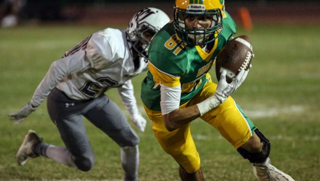 Coachella Valley's Ruben Sanchez completes a pass and carries it for a first down against Rancho Mirage on Friday, October 6, 2017 in Thermal.