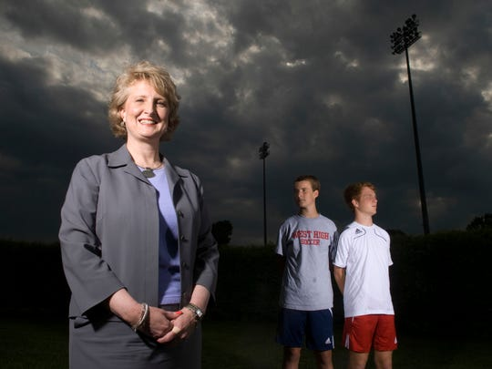 Lynne Fugate  and her sons, from left, Patrick Fugate, 14, and Henley Fugate, 17 at West High School grounds.
