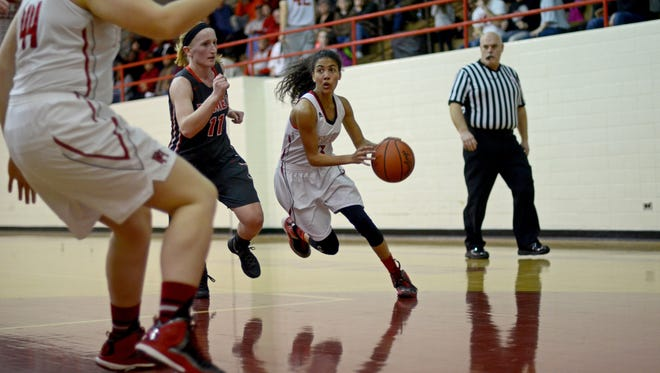 Big Reds' Kelsie Chapman drives to the basket Monday, Feb. 29, during a district basketball game at Port Huron High.