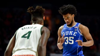 Duke Blue Devils forward Marvin Bagley III (35) looks at Miami Hurricanes guard Lonnie Walker IV (4) during a game last season. Both are projected to be first round NBA draft picks in 2018.