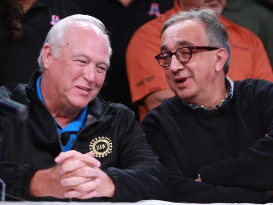 UAW President Dennis Williams and FCA CEO Sergio Marchionne chat during a press conference in the auditorium of the UAW-Chrysler NTC Building in Detroit after the UAW announced Tuesday that it has reached a tentative agreement with FCA US LLC.