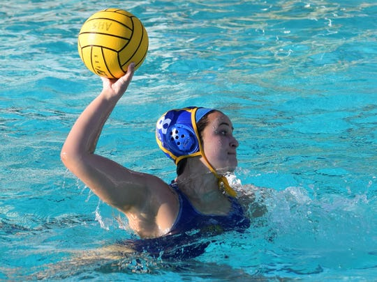 Kaitlin Gardhouse fires a shot during Agoura's win over Thousand Oaks on Monday in the Chargers' final Marmonte League game.