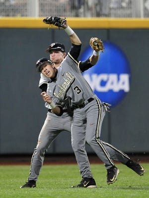 Vanderbilt's Jeren Kendall (3) has moved from left field to right field for his sophomore season, flanking center fielder Bryan Reynolds (back).