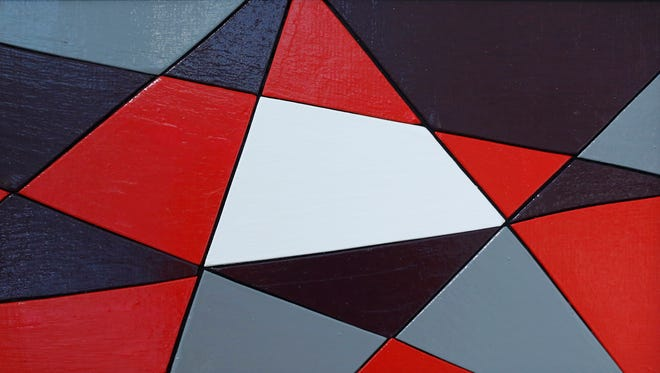 """A wood with enamel and clear coat piece by artist Daryl R Smith titled """"Triangles with Red and Purple"""" Tuesday, January 12, 2016, at Tippecanoe Arts Federation."""