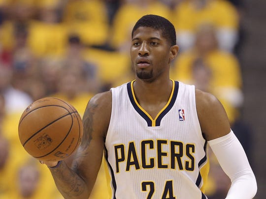 Indiana PacersÕ Paul George (24) brings the ball up court during the first half of action. The Indiana Pacers hosted the Miami Heat in Game 5 of the NBA Eastern Conference Finals Wednesday, May 28, 2014, at Bankers Life Fieldhouse in Indianapolis.
