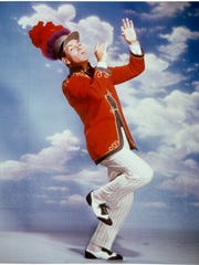 Robert Preston marching in a scene from the film 'The Music Man', 1962.