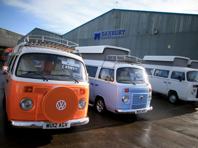 Some of the last of the Brazilian-built Volkswagen Type 2 vans, converted into luxurious camper vans. are shown at Danbury MotorCaravans in Bristol, England earlier this month.