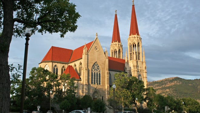 This 2011 file photo shows the Cathedral of St. Helena in Helena, Mont. The Roman Catholic Diocese of Helena filed for bankruptcy protection Jan. 31 in advance of proposed settlements for two lawsuits that claim clergy members sexually abused 362 people over decades and the church covered it up.