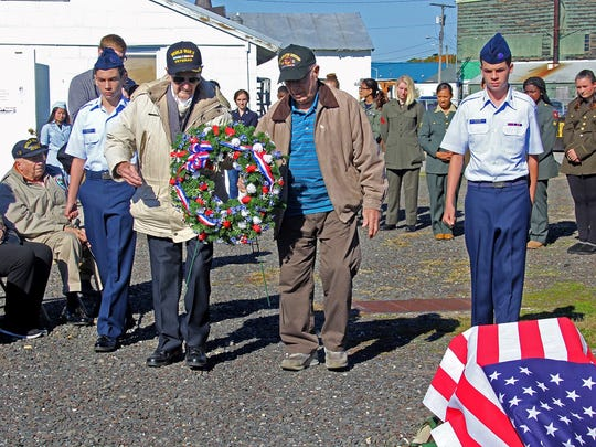 World War II veterans Tim Kiniry (left) of Minotola and Charles Titone of Burlington, escorted by members of the Cumberland Civil Air Patrol, participated in the wreath laying ceremony during Millville Army Air Field Museum's Veterans Appreciation Day 2016 at Millville Airport.
