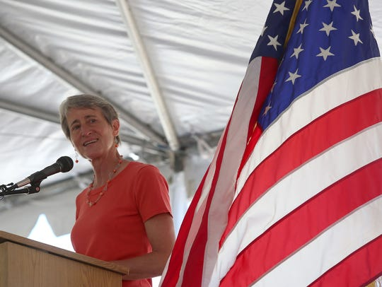 Interior Secretary Sally Jewell speaks before the signing
