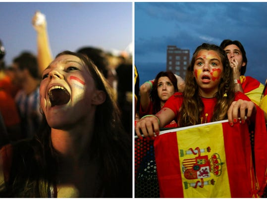 In this combination of Associated Press photos a Dutch fan, left, celebrates a goal scored by the Netherlands, in Rio de Janeiro, Brazil and, right, a Spanish soccer fan in Madrid watches on a giant display as the Netherlands defeat Spain during a World Cup soccer match Friday, June 13, 2014. (AP Photo)