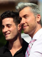 """Lance Bass and fiancé Michael Turchin step on the pink carpet for photos during a ceremony honoring """"Real Housewives of Beverly Hills"""" star Lisa Vanderpump with a new star on the Palm Springs Walk of Stars on Wednesday morning."""