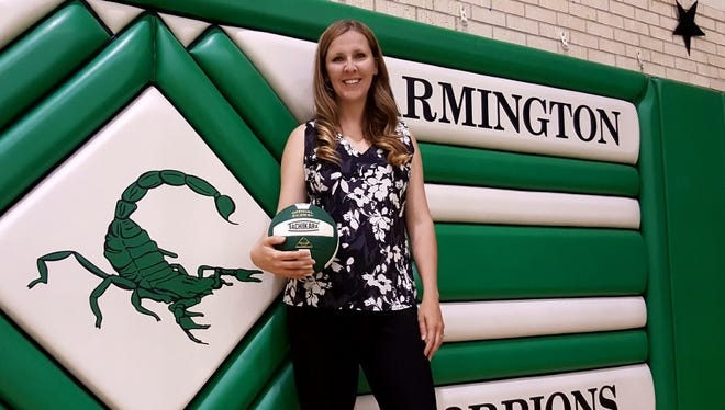 Alana Rowland poses for a photo on Tuesday at Scorpion Gym after taking over as the new head volleyball coach at Farmington High School.