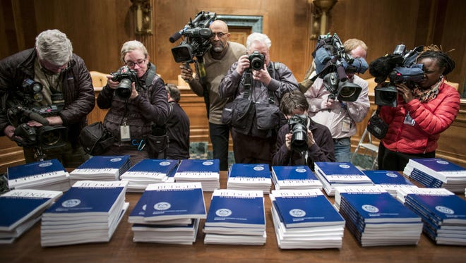 Members of the press take photos and video of copies of the Obama administration's proposed budget in the Senate Budget Committee hearing room on March 4.