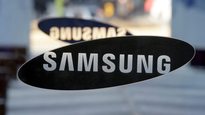 In this Jan. 8, 2015, file photo, a logo of Samsung Electronics is seen at its showroom in Seoul, South Korea.