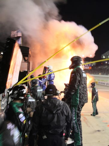 A fire burns on pit road during the the NASCAR Xfinity