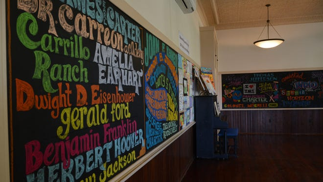 A local artist and Desert Sands Unified School District alumni inscribed the names of all of the district's schools on the walls of the Coachella Valley History Museum as part of the district's 50th anniversary.