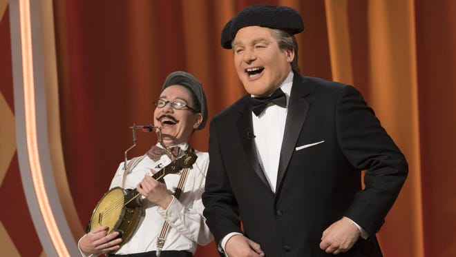 Host 'Tommy Maitland,' right, appears with a contestant on ABC's 'The Gong Show.'