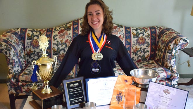 Grayson Katzenbach of Waynesboro poses with some of the academic and civic honors she received as a student at Piedmont Valley Community College in Charlottesville, as well as her trophies for winning the Senior Women's épée and foil at the U.S. Fencing Virginia District Championships in May.