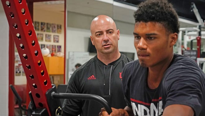 New IU strength and conditioning coach Clif Marshall works with Hoosiers freshman Josh Smith.