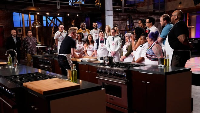 "On episode 5 of ""MasterChef,"" Gordon Ramsay does a master class for the contestants on how to break down a Dungeness crab before the contestants have to replicate his work. Nashville teacher Gerron Hurt is on the left in the yellow shirt."